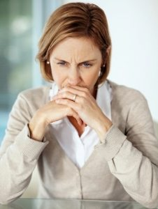 Disappointed mature businessswoman thinking over something